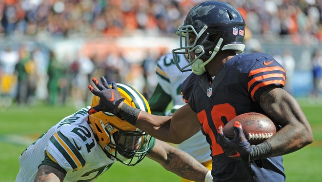 Green Bay Packers safety Ha Ha Clinton-Dix (21) makes a tackle on receiver Marquess Wilson (10) against the Chicago Bears at Soldier Field September 13, 2015