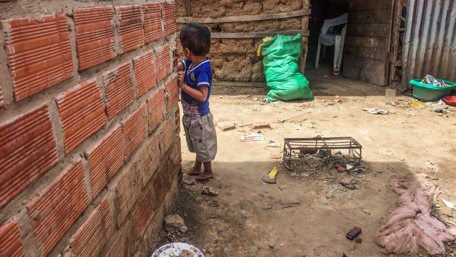 A child plays in an Ayoreo village on the edge of Santa Cruz de la Sierra, Bolivia.