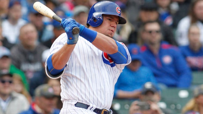 Chicago Cubs left fielder Kyle Schwarber (12) hits an RBI single during the fifth inning against the Pittsburgh Pirates at Wrigley Field on April 14.