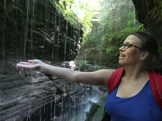 Outdoors reporter Victoria Freile reaches out into