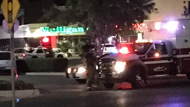 El Paso police investigate a July 30 shooting at Mulligan's Chopped Hog bar, 1810 George Dieter Drive.
