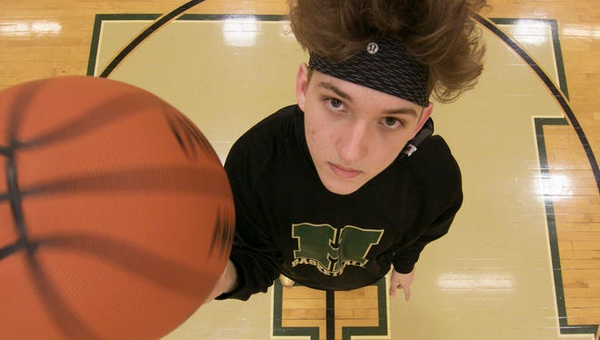 Howell High School's Josh Palo, the boys' Basketball Player of the Year, spins a basketball on his finger in the center of the school's court Tuesday, March 20, 2018.
