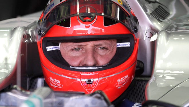 FILE - In this Nov. 23, 2012 file photo, Grand Prix driver Michael Schumacher, of Germany, sits in his car during a free practice at the Interlagos race track in Sao Paulo, Brazil.