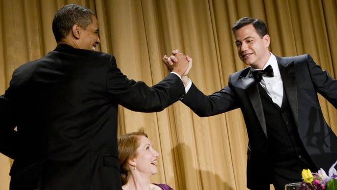 President Obama gives a high-five to Jimmy Kimmel at the 2012 White House Correspondents' Association Dinner in 2012.