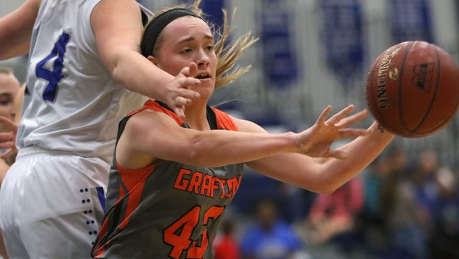 Grafton's Hannah Belanger passes away from Whitefish Bay's Elise Whitmoyer during the varsity game in Whitefish Bay High School Tuesday, Nov. 29, 2016, in Whitefish Bay, Wisconsin.