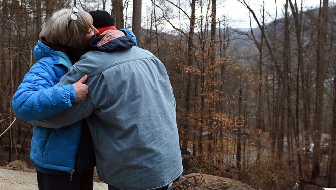 Dec 9, 2016; Gatlinburg, TN, USA; Sue Thompson hugs her son, Mike, as they visit their burned home in Gatlinburg, Tenn.  Disaster relief organizations All Hands Volunteers and Reach Out Worldwide are helping the family as the resort city reopens to the public nearly two weeks after a devastating wildfire killed 14 people, injured 176 and burned more than 2,400 structures. Mandatory credit: Amy Smotherman Burgess/Knoxville News Sentinel via USA TODAY NETWORK