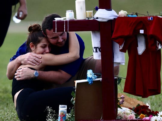 Sad scenes of remembrances are still playing out at the Parkland amphitheater on Feb. 17, 2018. Crosses have been set up to honor those killed in the Marjory Stoneman Douglas High School shooting.  Credit: Andrew West, The News-Press via USA TODAY Network