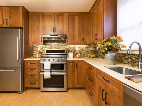 The backsplash behind your sink, stove and countertops doesn't have to be the same material or color as the countertop.