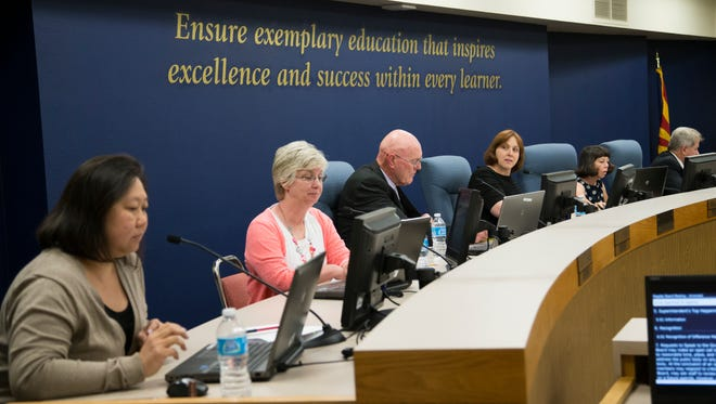 Gilbert school board members (from left) Lily Tram, Jill Humpherys, then-Superintendent Jim Rice, board president Staci Burk, Julie Smith and Daryl Colvin conduct a meeting in March.