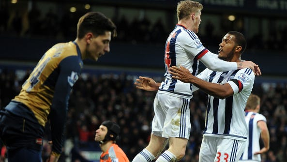West Brom's James McClean, centre, celebrates with