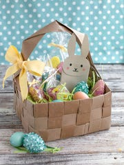 This undated photo shows an upcycled DIY Easter basket made from four brown paper grocery bags, cut into strips and woven together. Fresh takes on Easter baskets for kids include a heavy dose of do-it-yourself ingenuity.