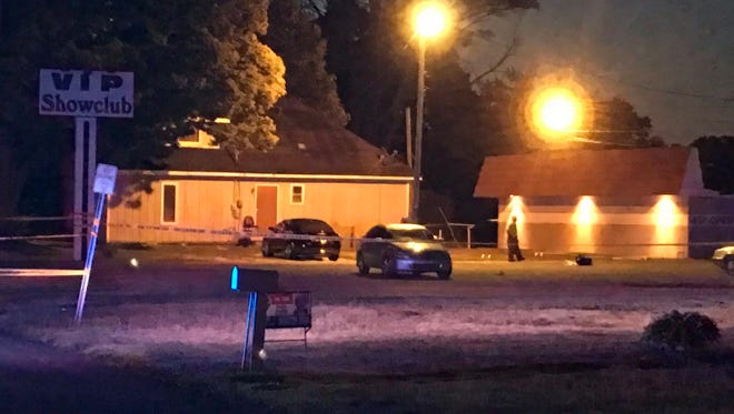Marion police investigate a shooting at the VIP Showclub on Friday.
