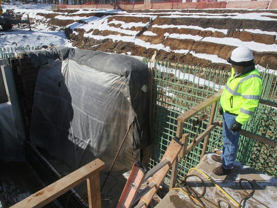 Construction manager Bob Hawk of G. Stephens, Inc. looks over an addition under construction at Akron's Retention Tank 2 site on Feb. 13 in Akron, Ohio.