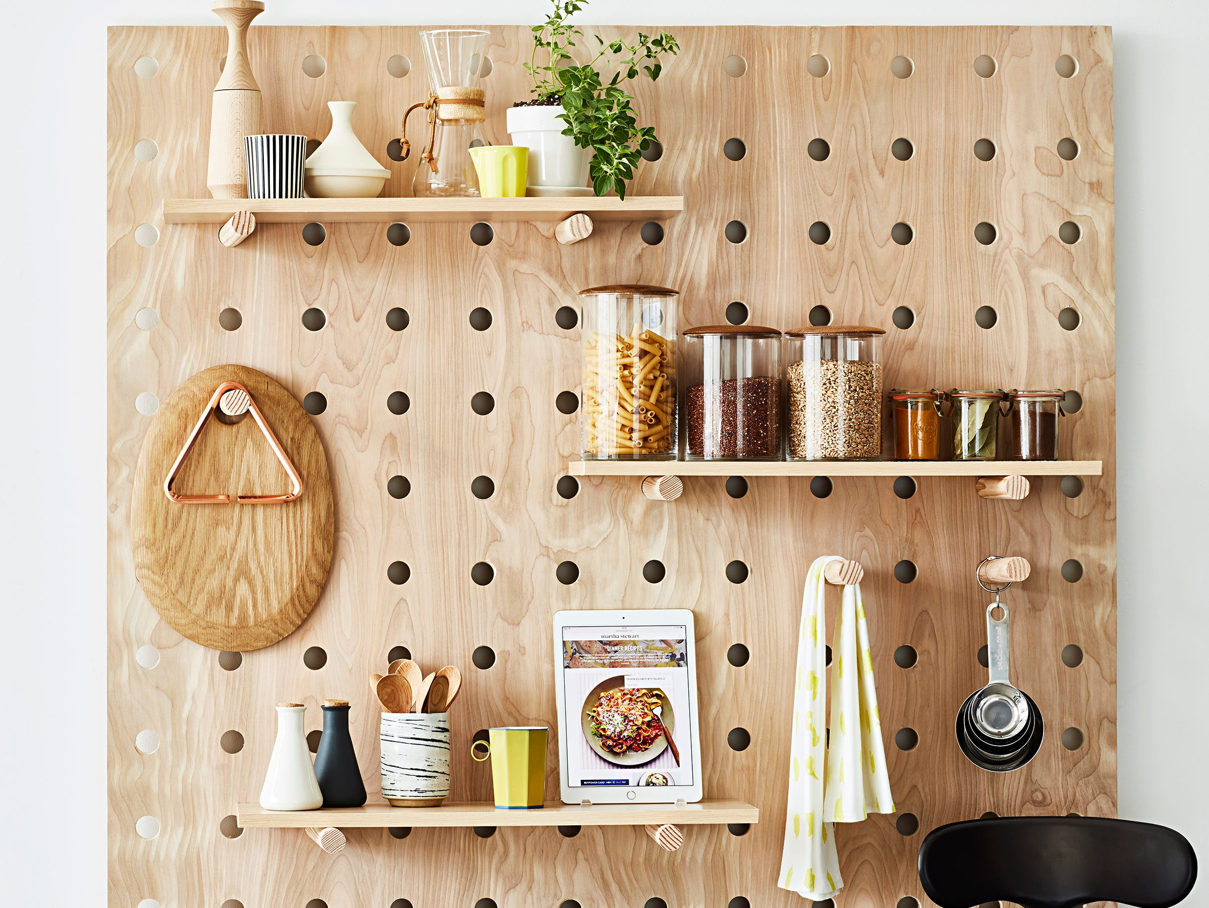A few cleverly placed shelves, hooks and baskets can turn a small kitchen into a chef's paradise.