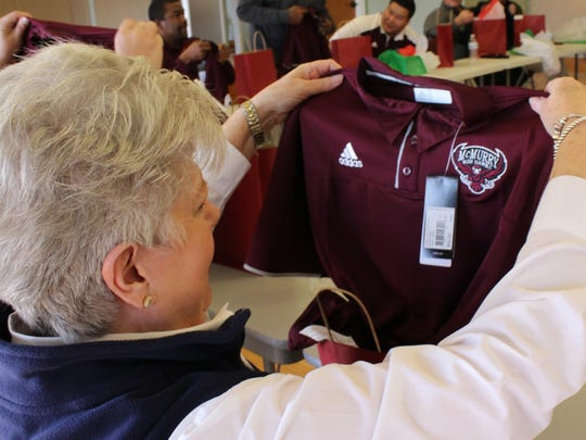 Just what Debbie Ford wanted for Christmas ... a new McMurry War Hawks logo shirt. McMurry staff showed their appreciation for Ford by nominating her as an Everyday Hero.