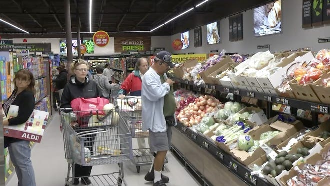 Customers shop during the opening day of the new Aldi location in Milltown.