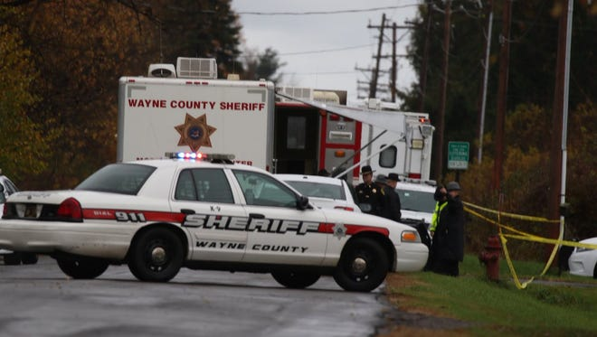 Wayne County sheriff's deputies investigate on Boyd Road in Sodus, where a 17-year-old girl was killed on Nov. 2, 2017.