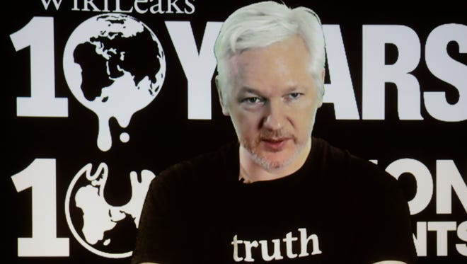In this Oct. 4, 2016 photo, WikiLeaks founder Julian Assange participates via video link at a news conference marking the 10th anniversary of the secrecy-spilling group in Berlin.
