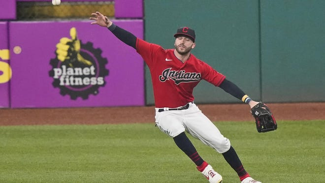 Cleveland Indians' Tyler Naquin can't catch a ball hit by Kansas City Royals' Edward Olivares during the ninth inning of a baseball game Wednesday, Sept. 9, 2020, in Cleveland. Olivares tripled and Alex Gordon scored. The Royals won 3-0.