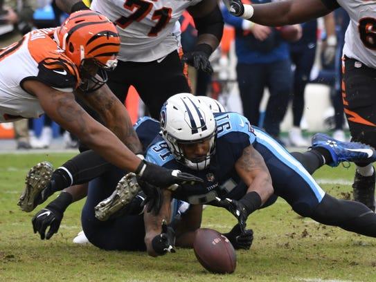 Titans linebacker Derrick Morgan (91)  picks up a fumble