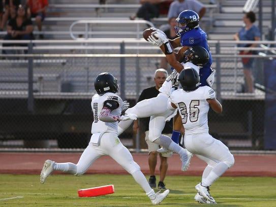 Chandler Gunner Romney, WR, #18, catches the ball for