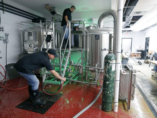 Doing some maintenance, Brad and Kyle Kennedy are the owners of K2 Brothers Brewing Penfield which is opening soon.