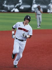 U of L's Brendan McKay (38) rounds third base after hitting a grand slam home run against Eastern Kentucky at Jim Patterson Stadium.Feb. 22, 2017