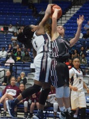 Houma Christian's Da'Lesia Williams (left) blocks Vermilion Catholic's Ainsley Mallet as Mallet tries to shoot in the LHSAA Division IV semifinals held Thursday at the Rapides Parish Coliseum in Alexandria.