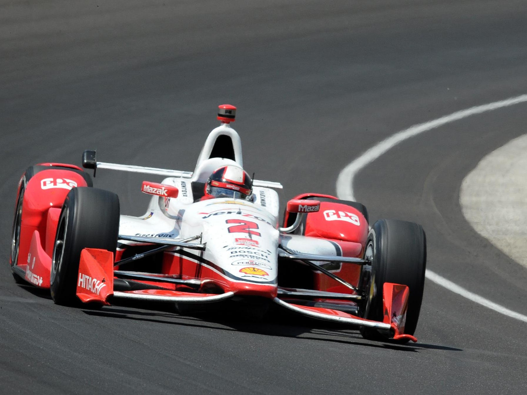 Juan Pablo Montoya (2) of Team Penske navigates his car through turn one during the 99th running of The Indianapolis 500, May 23, 2015, in Speedway, Ind.