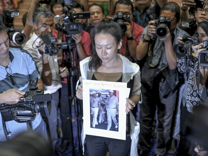 A relative (C) of a passenger of the missing Malaysia