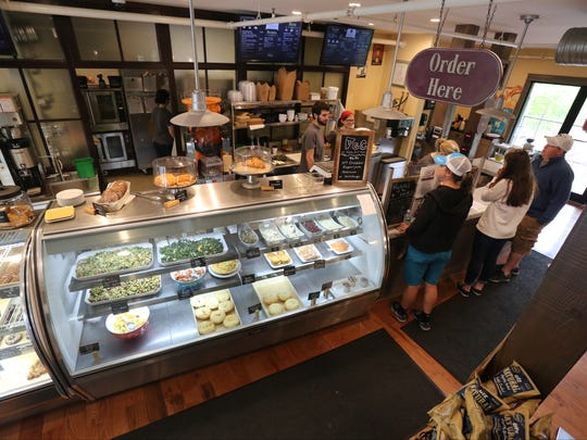 People place their orders at the front counter at Frida's