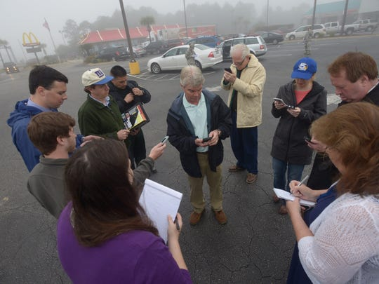 Mike Spaits, center, spokesman for Eglin Air Force Base, updates reporters at a command post in Navarre, Fla., Wednesday, March 11, 2015. Seven Marines and four soldiers aboard an Army helicopter that crashed over waters off Florida during a routine night training mission were presumed dead Wednesday, and crews found human remains despite heavy fog.
