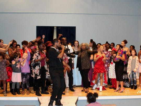 Norez sings with kids during the BE YOU Youth Talent