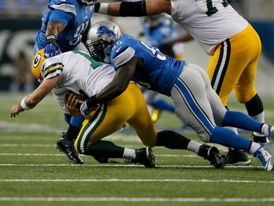 Detroit Lions linebacker Stephen Tulloch, right, sacks Green Bay Packers quarterback Aaron Rodgers on Sept. 21, 2014.