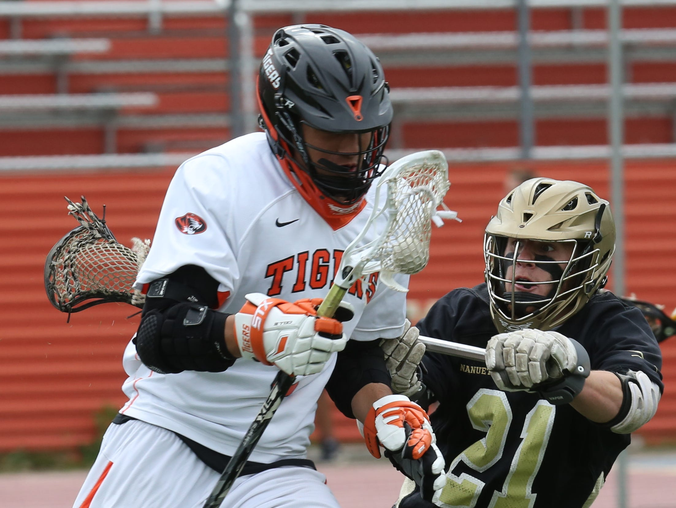 Nanuet's Brian McGreevy (21) tries to steal the ball from Leo DeSousa (5) of White Plains during boys lacrosse game at White Plains High School May 10, 2016. White Plains defeats Nanuet 14-4.