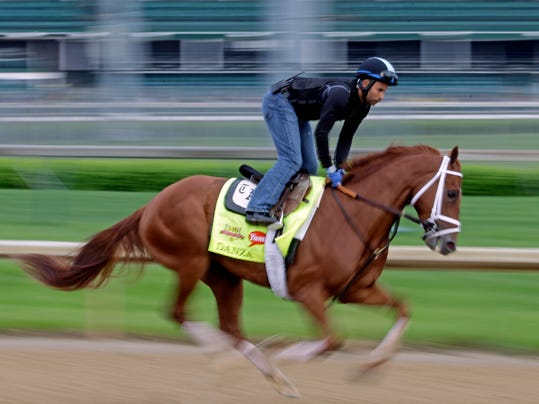 Exercise rider Ezequiel Perez takes Kentucky Derby hopeful Danza for a morning workout at Churchill Downs Wednesday, April 30, 2014, in Louisville, Ky. (AP Photo/Morry Gash)