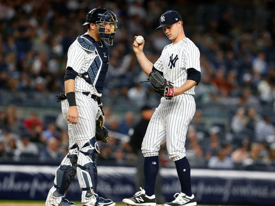 New York Yankees catcher Austin Romine (28) talks to New York Yankees starting pitcher Sonny Gray (55) in the fourth inning against the Oakland Athletics at Yankee Stadium.