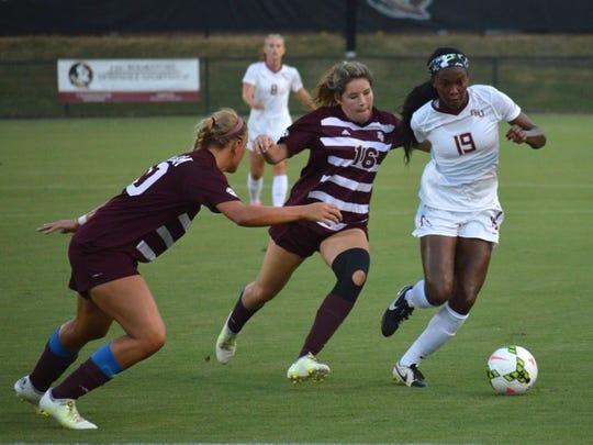 Cheyna Williams fends off an Aggie defender in FSU's