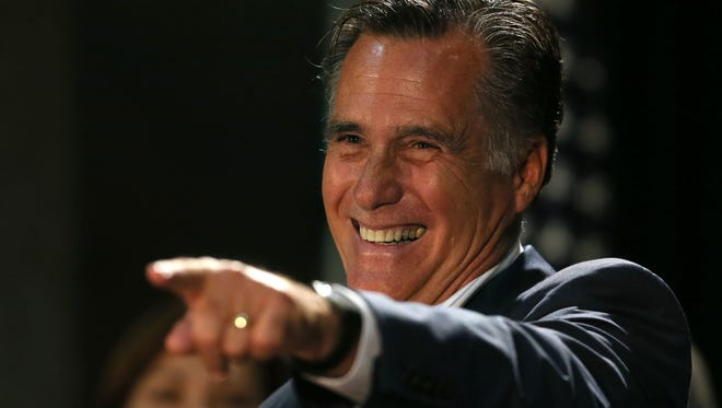 Former Republican presidential nominee Mitt Romney campaigns for Joni Ernst at Iowa Farm Bureau Headquarters. Ernst is in a close race with Bruce Braley for the U.S. Senate seat being vacated by Tom Harkin. Sunday, Oct. 12, 2014.