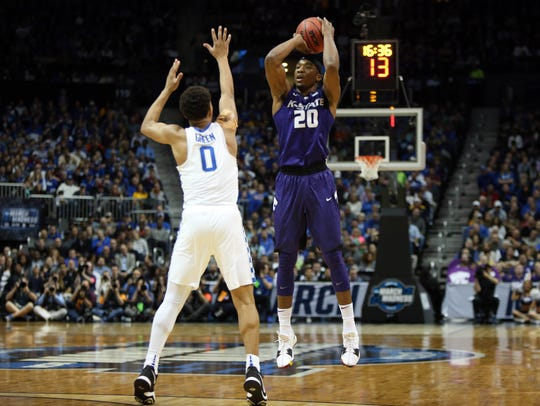 Kansas State Wildcats forward Xavier Sneed rises to