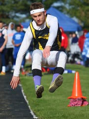 Colonel Crawford's Owen Adams competes in the long