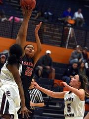 Oakland senior Maddie Cook takes a jump shot during