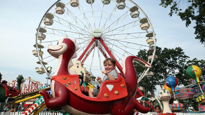 Jackson O'Connell, 3, of Yorktown, rides the Flying Dragon at Playland Aug. 31 in Rye.