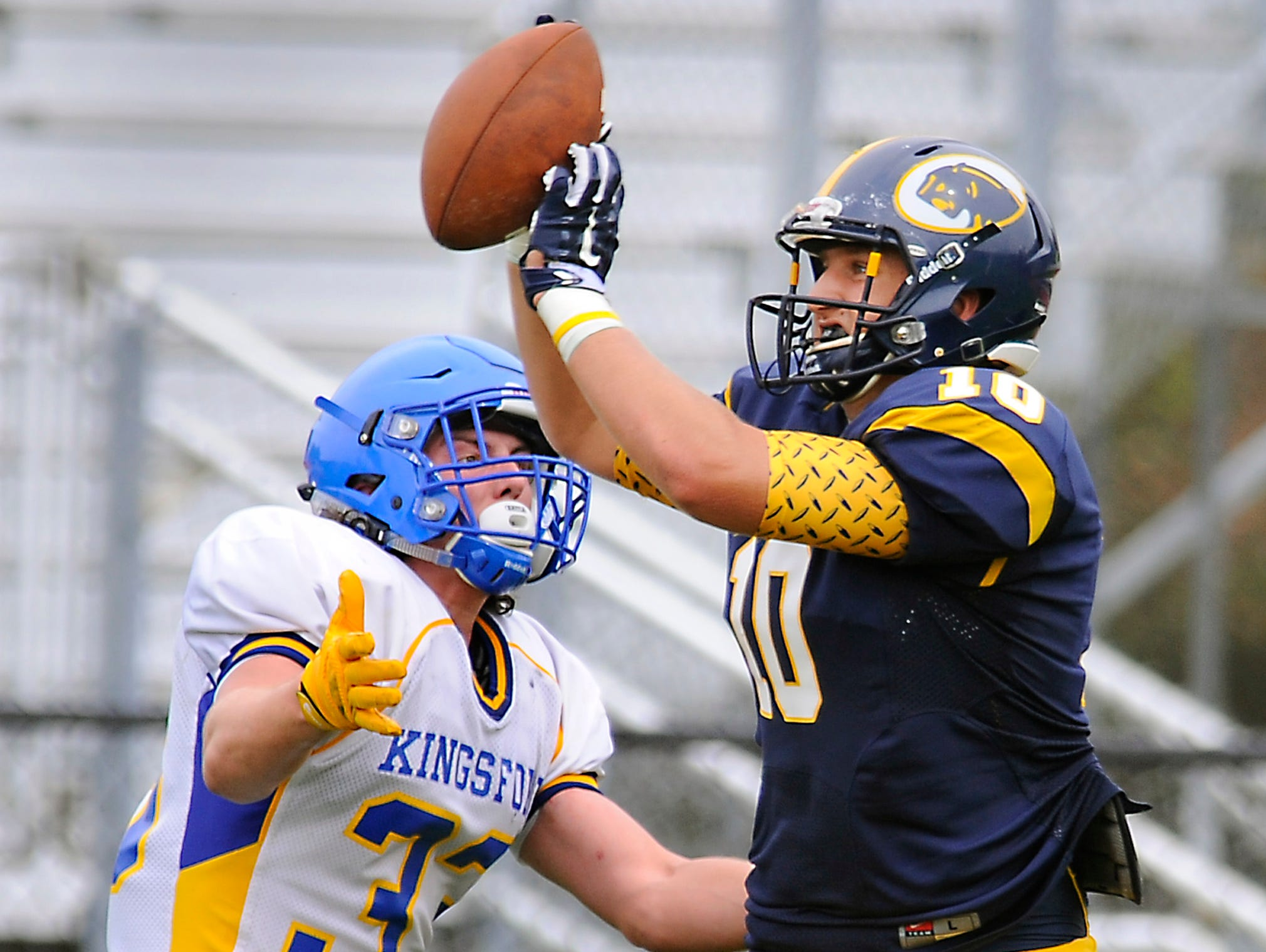 DeWitt tight end Evan Conn makes a fingertip catch on a pass from quarterback Will Nagel for a first down past Kingsford's Sam Santi Thursday 9/3/2015. First of a two-picture series.