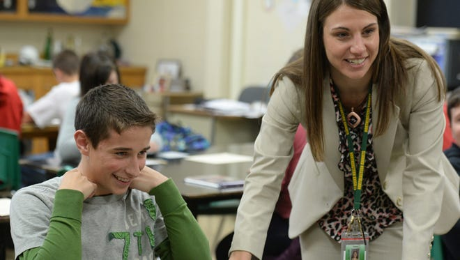 Northeastern Middle School principal Dawn Sonsini talks with Tanner Wilson, left, and other students during class Friday, Nov. 21, 2014.