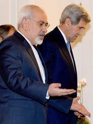 Secretary of State John Kerry, right,  and Iranian