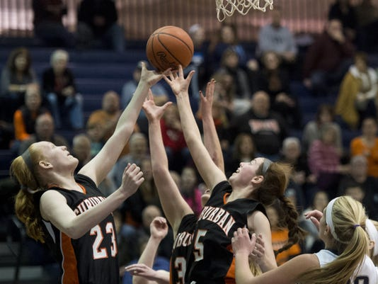 York Suburban players fight for a loose ball during Sunday's game against West York. The Trojans will continue play in the consolation bracket of the District 3 Class AAA tournament, when they face Lancaster Catholic on Tuesday.