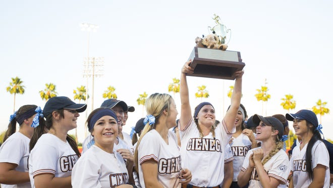Cienega's Melanie Cross (18) raises the D2 State Softball Championship Trophy above her head after the team beat Salpointe for the title at Farrington Softball Stadium in Tempe, AZ on May 18, 2015.