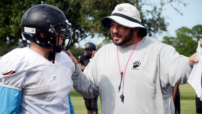 Bayside High head coach Mike Nahl speaks with a player during practice Wednesday in Palm Bay.