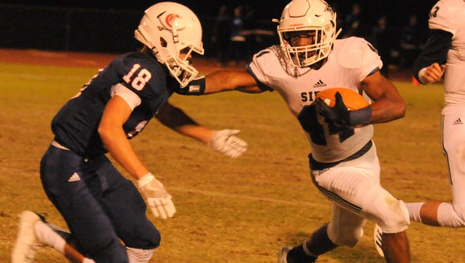 Siegel running back Lelan Wilhoite (44) rushed for more than 200 yards and had more than 100 receiving yards in Thursday's game against Cookeville.